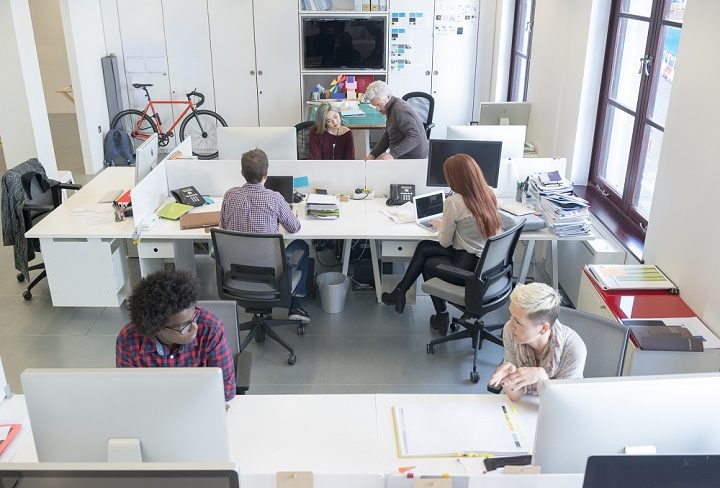 Modern business people in busy office