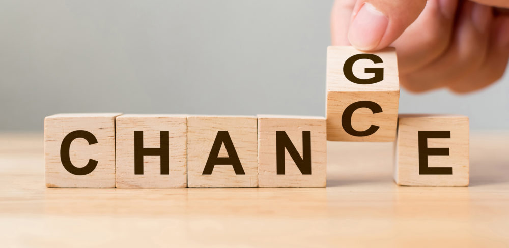Hand flip wooden cube with word « change » to « chance », Personal development and career growth or change yourself concept